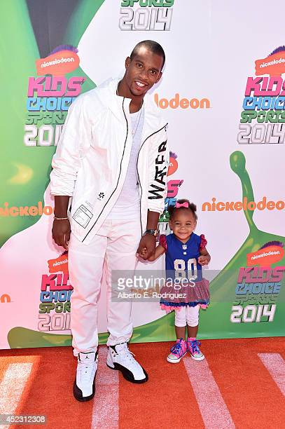 NFL player Victor Cruz with daughter Kennedy Cruz attends Nickelodeon Kids' Choice Sports Awards 2014 at UCLA's Pauley Pavilion on July 17 2014 in...