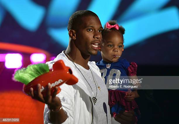NFL player Victor Cruz with daughter Kennedy Cruz onstage during Nickelodeon Kids' Choice Sports Awards 2014 at UCLA's Pauley Pavilion on July 17...