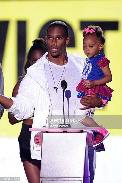 NFL player Victor Cruz with daughter Kennedy speaks onstage during Nickelodeon Kids' Choice Sports Awards 2014 at UCLA's Pauley Pavilion on July 17...