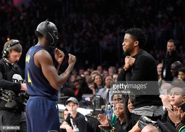 NBA player Victor Oladipo of the Indiana Pacers puts on Marvel's Black Panther mask from Chadwick Boseman during the 2018 State Farm AllStar Saturday...