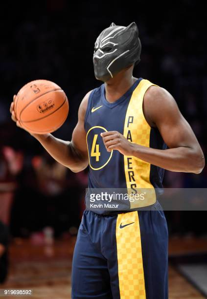 NBA player Victor Oladipo of the Indiana Pacers wearing Marvel's Black Panther mask from Chadwick Boseman during the 2018 State Farm AllStar Saturday...