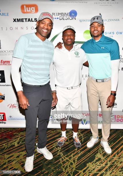 Player Vince Carter actor Chris Tucker and NBA Player Kent Bazemore attend the Chris Tucker Foundation Celebrity Golf Tournament at Stone Mountain...