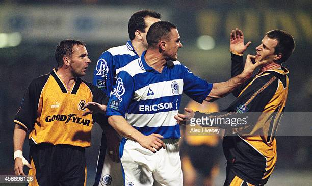 QPR player Vinnie Jones gets to grips with Wolves player Steve Claridge as Paul Simpson and Neil Ruddock look on during a League Division One match...