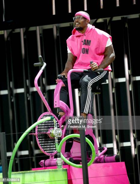 NFL player Von Miller rides exercise bike onstage during Nickelodeon Kids' Choice Sports Awards 2017 at Pauley Pavilion on July 13 2017 in Los...