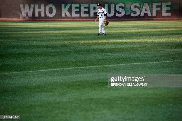 TOPSHOT A player waits for the Congressional Baseball Game between Democrats and Republicans at Nationals Stadium June 15 2017 in Washington DC This...