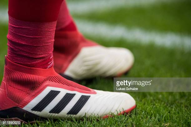 A player wears Adidas Predator boots during the Bundesliga match between Bayer 04 Leverkusen and 1 FSV Mainz 05 at BayArena on January 28 2018 in...