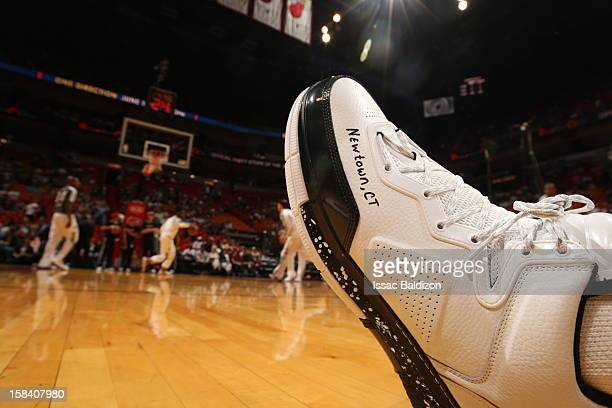 A player wears snickers with Newtown CT to express grief for victims of the school shooting during a game between the Washington Wizards and the...