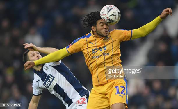 WBA player Wes Hoolahan is beaten to the ball by Reece James of Wigan during the FA Cup Third Round match between West Bromwich Albion and Wigan...
