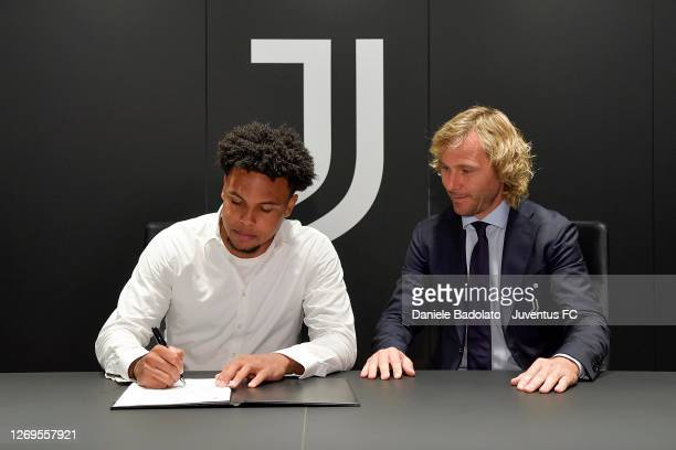 Player Weston McKennie with Pavel Nedved signing for Juventus on August 28, 2020 in Turin, Italy.