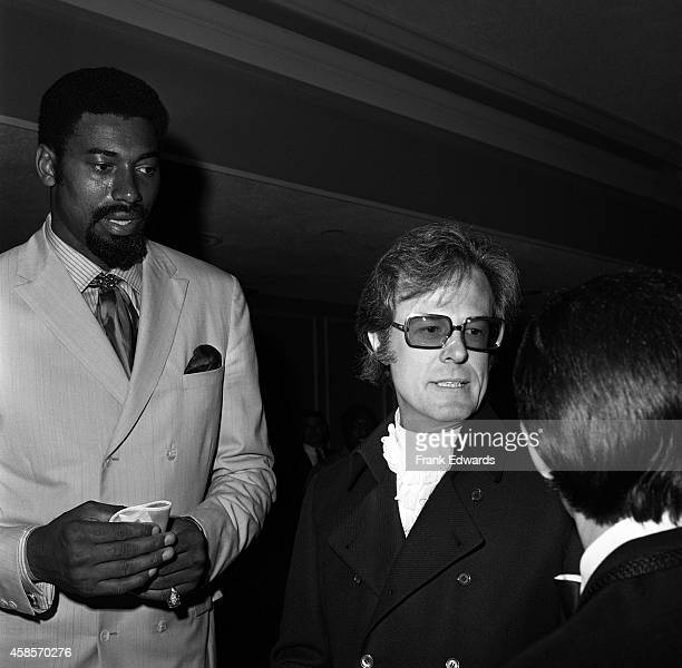 NBA player Wilt Chamberlain and actor Robert Culp attend the opening of the International Hotel in July 1969 in Las Vegas Nevada