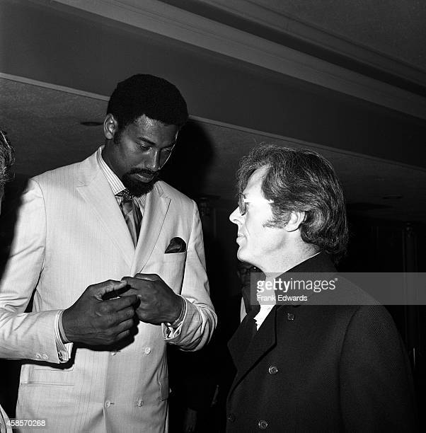 NBA player Wilt Chamberlain and actor Robert Culp talk while attending the opening of the International Hotel in July 1969 in Las Vegas Nevada