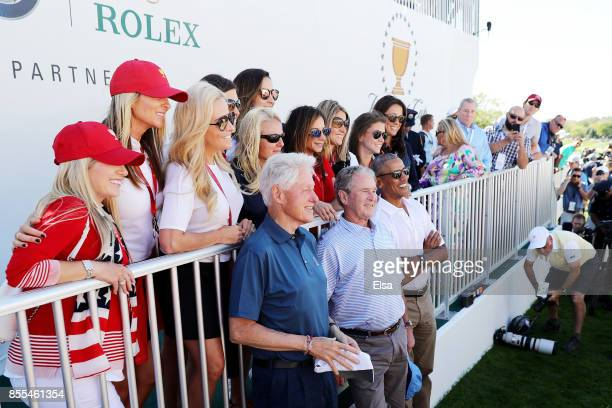 Player wives and girlfriends pose with former US Presidents Bill Clinton George W Bush and Barack Obama prior to Thursday foursome matches of the...