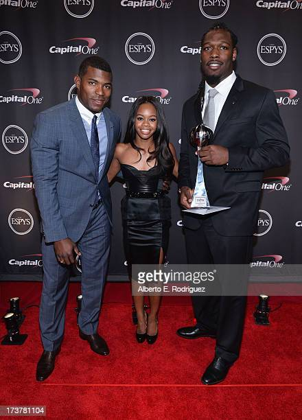 MLB player Yasiel Puig Olympic athlete Gabby Douglas and Best Play award winner Jadeveon Clowney pose backstage at The 2013 ESPY Awards at Nokia...