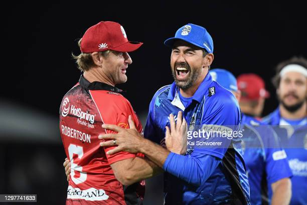 Player-coach Stephen Fleming of Team Cricket is congratulated by Manager Scott Robertson of Team Rugby after the win in the 2021 Black Clash at...