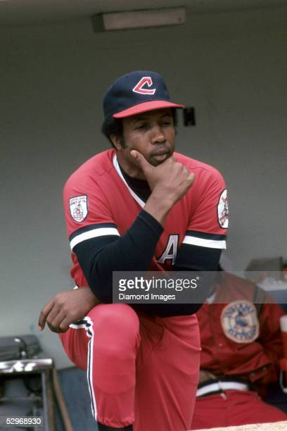 Player/Manager Frank Robinson of the Cleveland Indians reviews his troops from the dugout steps during a game in June 1976 at Municipal Stadium in...