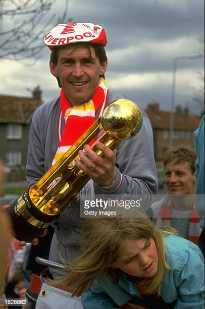 Player/Manager Kenny Dalglish of Liverpool holds the Canon League Division One trophy during their homecoming after the FA Cup final against Everton...