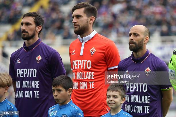 Players ACF Fiorentina line up wearing the shirt in support of former teammate Giuseppe Rossi during the Serie A match between ACF Fiorentina and...