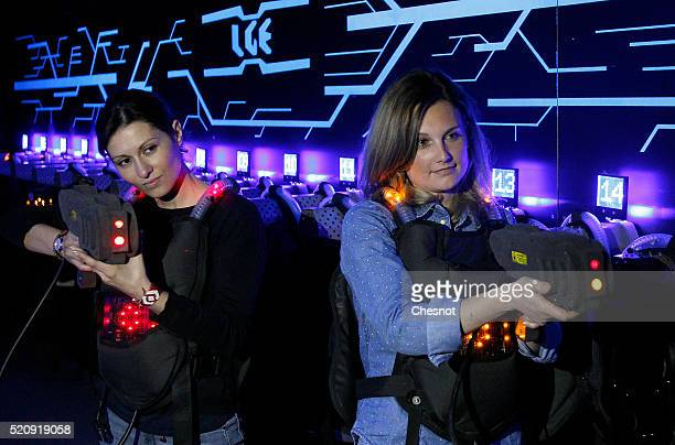 Players aim with laser guns in a games centre 'Laser Game Evolution' on April 13 2016 in BretignysurOrge France Laser Game Evolution the French...