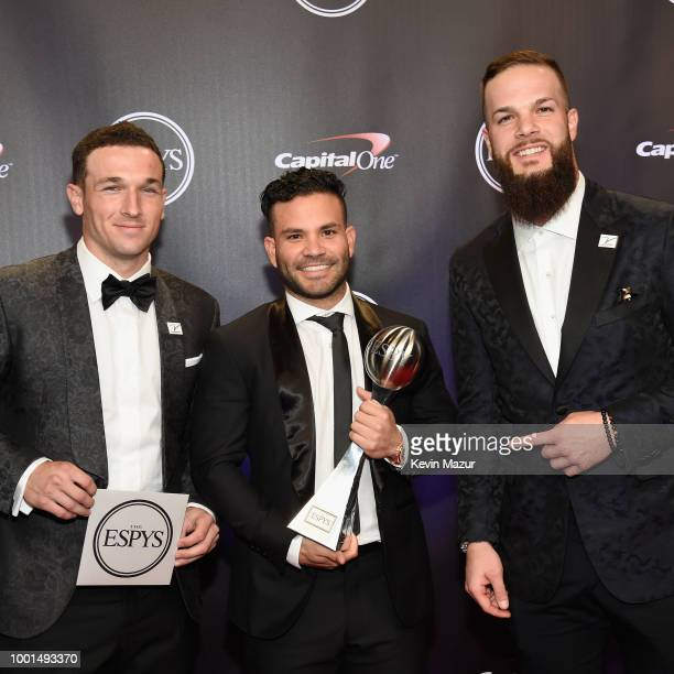 MLB players Alex Bregman Jose Altuve and Dallas Keuchel of the Houston Astros pose with the award for Best Team during The 2018 ESPYS at Microsoft...