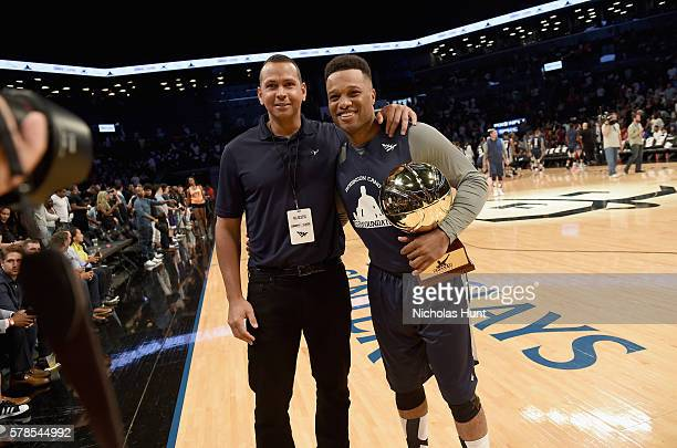 MLB players Alex Rodriguez and Robinson Canó pose with trophy at the Roc Nation Summer Classic Charity Basketball Tournament at Barclays Center of...