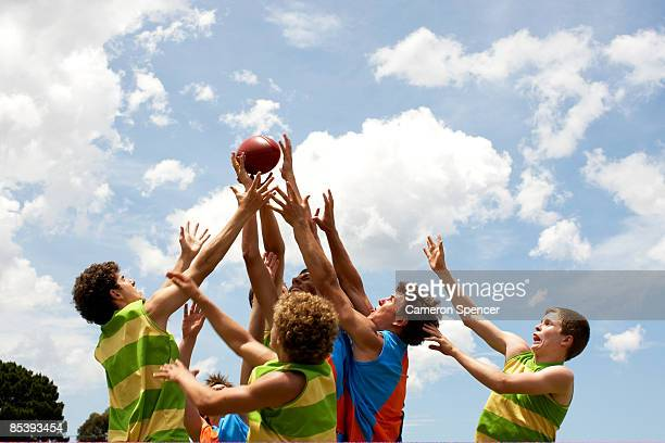 players all competing for australian football - afl stock pictures, royalty-free photos & images