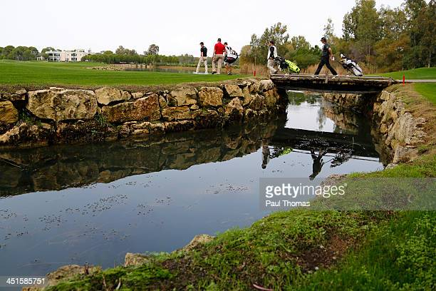 Players and caddies make their way down the 18th fairway during day one of the Titleist PGA Playoffs on the PGA Sultan Course at Antalya Golf Club on...