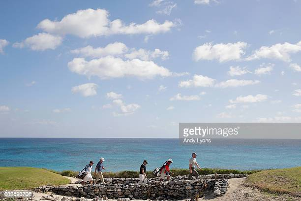 Players and caddies walk over a rock bridge on the 18th hole during the second round of The Bahamas Great Abaco Classic at the Abaco Club on January...