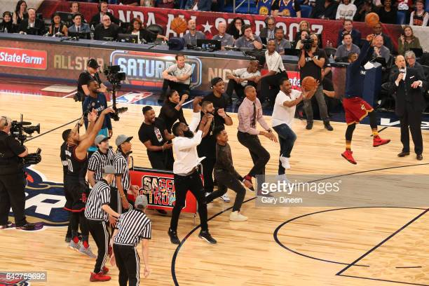 Players and celebrities shoot a three point basket for charity after the JBL ThreePoint Contest during State Farm AllStar Saturday Night as part of...