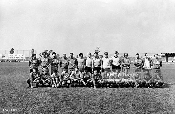 Players and coaches choosen for the National football team of Italy on the occasion of the Football World Cup or World Cup Jules Rimet posing on a...