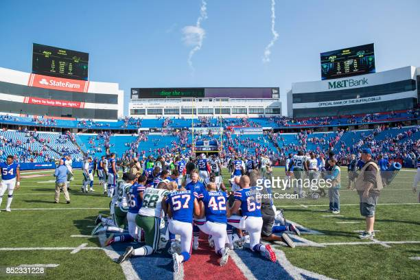 Players and coaches from both teams pray after the game between the Buffalo Bills and the New York Jets on September 10 2017 at New Era Field in...