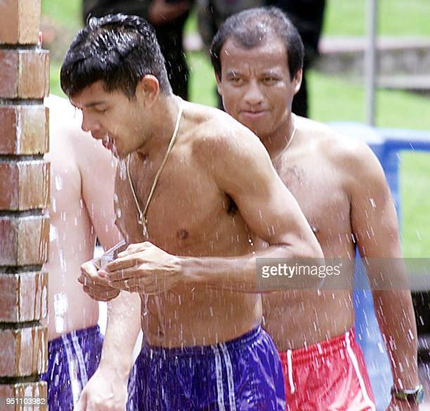 Players and coaches of the Honduras soccer team relax at a thermal pool 24 July 2001 in Manizales Colombia The Hondurans scored one of the greatest...