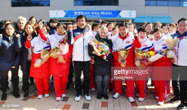 Players and coaches of the North and South Korean women's ice hockey teams pose for a commemorative photo in Jincheon South Korea on Jan 25 2018 The...