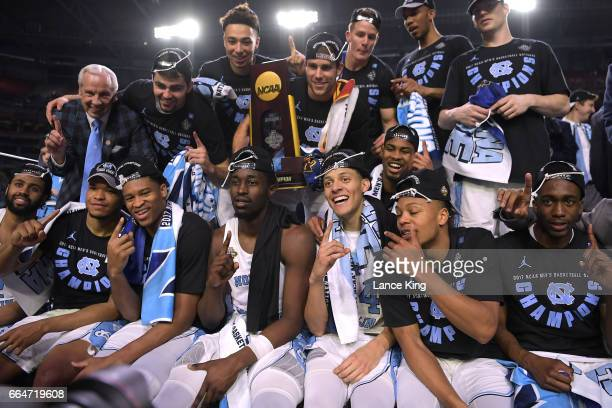 Players and coaches of the North Carolina Tar Heels celebrate following their 7165 victory against the Gonzaga Bulldogs during the 2017 NCAA Men's...