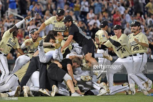 Players and coaches of the Vanderbilt Commodores celebrate after defeating the Michigan Wolverines to win the National Championship at the College...