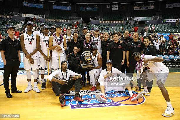 Players and coaches off the San Diego State Aztecs pose for a picture after winning the Championship Game of the Diamond Head Classic against the San...