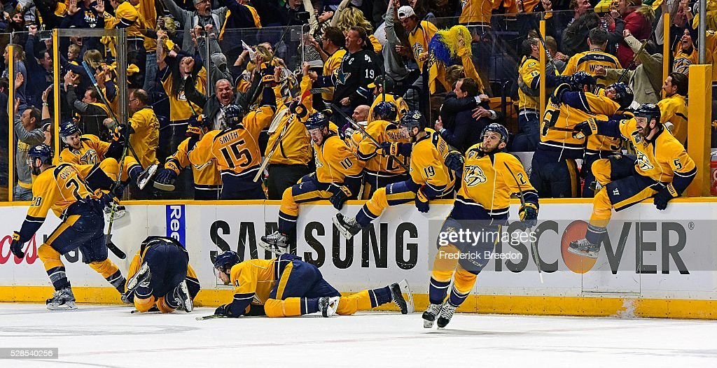 Players and coaches on the Nashville Predators bench erupt in celebration after winning 4-3 in the third overtime period of Game Four of the Western Conference Second Round against the San Jose Sharks during the 2016 NHL Stanley Cup Playoffs at Bridgestone Arena on May 5, 2016 in Nashville, Tennessee.