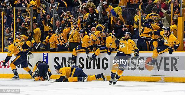 Players and coaches on the Nashville Predators bench erupt in celebration after winning 4-3 in the third overtime period of Game Four of the Western...