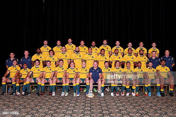 Players and coaches pose for a team photo at Sanctuary Cove on June 3 2014 in Gold Coast Australia