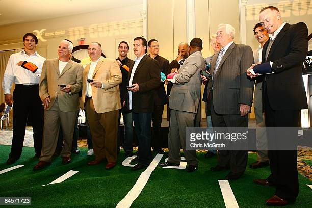 Players and coaches test out the ID Coach at the launch of the Isaac Daniel, ID Coach at the Sheraton Riverwalk on January 31, 2009 in Tampa,...