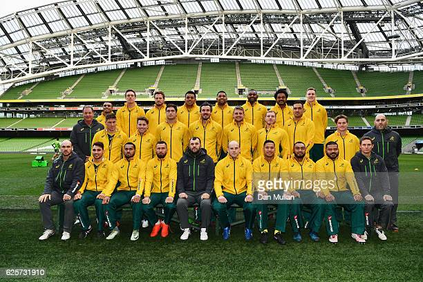 Players and coaching staff pose prior to the Australia Captain's Run on the eve of their international match against Ireland at Aviva Stadium on...