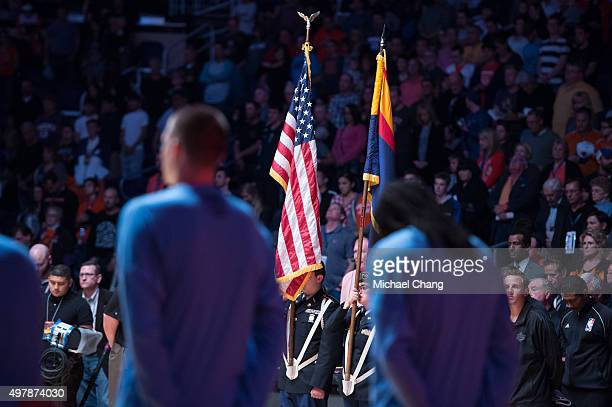 Players and fans bow heads for a moment of silence in honor of the victims in France prior to the match between the Phoenix Suns and the Denver...