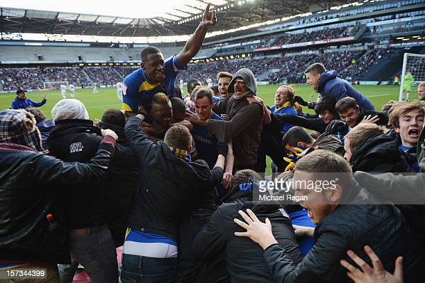 Players and fans celebrate as Jack Midson of AFC Wimbledon scores their first goal during the FA Cup with Budweiser Second Round match between MK...