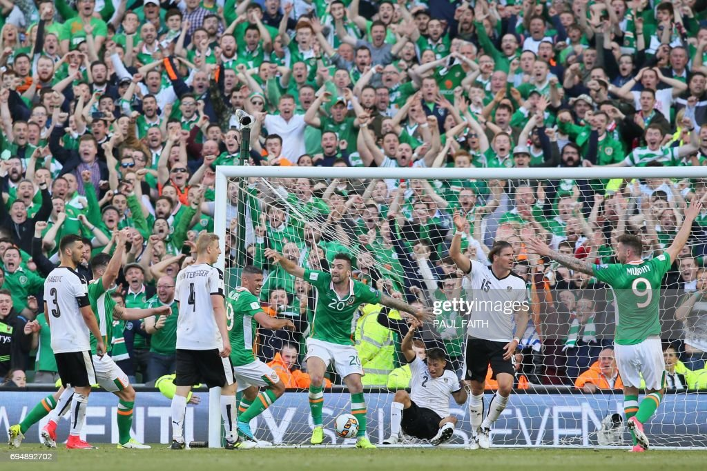 Players and fans celebrate but Ireland's goal is disallowed during the group D World Cup qualifying football match between Republic of Ireland and Austria at Aviva stadium in Dublin on June 11, 2017. The game finished 1-1. / AFP PHOTO / Paul FAITH