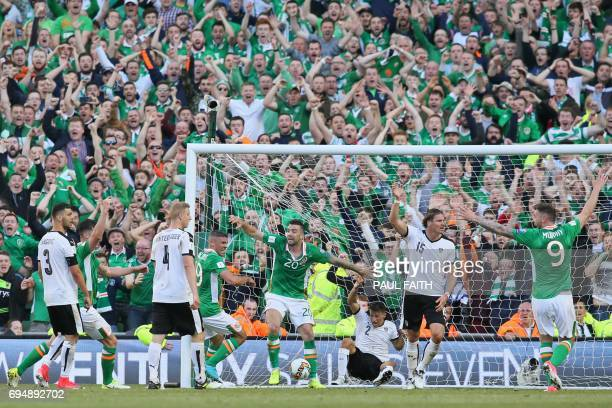 Players and fans celebrate but Ireland's goal is disallowed during the group D World Cup qualifying football match between Republic of Ireland and...