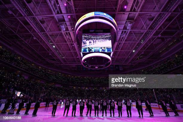 Players and fans join in a moment of silence before the San Jose Sharks and Vancouver Canucks game at SAP Center on November 23 2018 in San Jose...