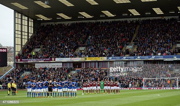 Players and fans observe a minute's silence for the victims of the May 11 1985 Bradford City stadium fire before the English Premier League football...
