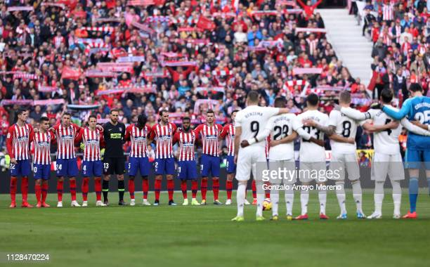 Players and fans observe a silence prior the La Liga match between Club Atletico de Madrid and Real Madrid CF at Wanda Metropolitano on February 09...