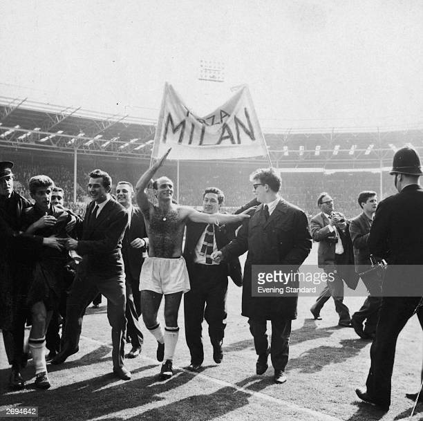 Players and fans of AC Milan celebrate their victory over Benfica in the European Cup Final at Wembley