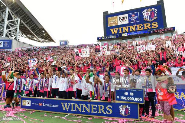 Players and fans of Cerezo Osaka celebrate as captain Yoichiro Kakitani lifts the trophy after the JLeague Levain Cup final match between Cerezo...