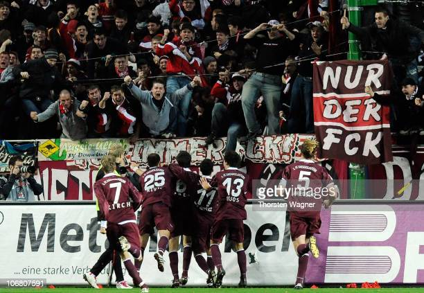 Players and fans of Kaiserslautern celebrate after Mathias Abel scored the 33 during the Bundesliga match between 1FC Kaiserslautern and VFB...